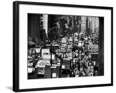 Pre-Christmas Holiday Traffic on 57th Avenue, Teeming with Double Decker Busses, Trucks and Cars-Andreas Feininger-Framed Photographic Print