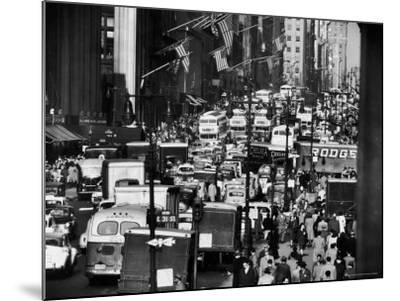 Pre-Christmas Holiday Traffic on 57th Avenue, Teeming with Double Decker Busses, Trucks and Cars-Andreas Feininger-Mounted Photographic Print