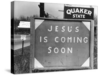 Penna US 1 Highway Sign Left of Quaker State Sign Looming Above Jesus is Coming Soon Billboard-Margaret Bourke-White-Stretched Canvas Print