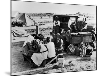 Suppertime for Oklahoma Family Follow Crops from California to Washington during the Depression-Dorothea Lange-Mounted Photographic Print