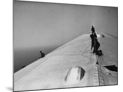 Maintenance Crewmen on Top of Graf Zeppelin repair damage caused Atlantic Ocean Storm during flight-Alfred Eisenstaedt-Mounted Photographic Print
