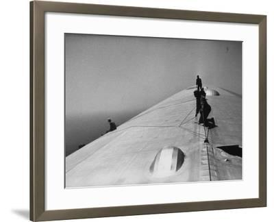 Maintenance Crewmen on Top of Graf Zeppelin repair damage caused Atlantic Ocean Storm during flight-Alfred Eisenstaedt-Framed Photographic Print