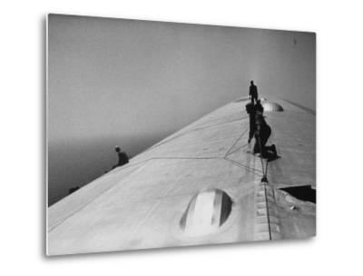 Maintenance Crewmen on Top of Graf Zeppelin repair damage caused Atlantic Ocean Storm during flight-Alfred Eisenstaedt-Metal Print