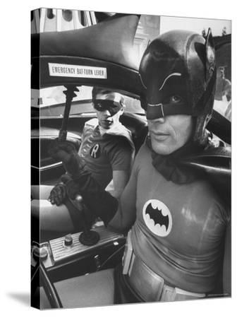 """Batman Adam West and """"Robin"""" Burt Ward in Bat Mobile, on Set During Shooting of Scene-Yale Joel-Stretched Canvas Print"""