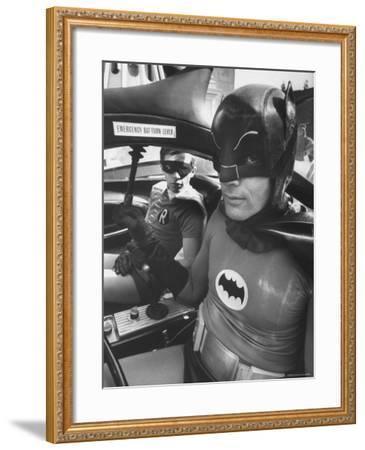 "Batman Adam West and ""Robin"" Burt Ward in Bat Mobile, on Set During Shooting of Scene-Yale Joel-Framed Premium Photographic Print"