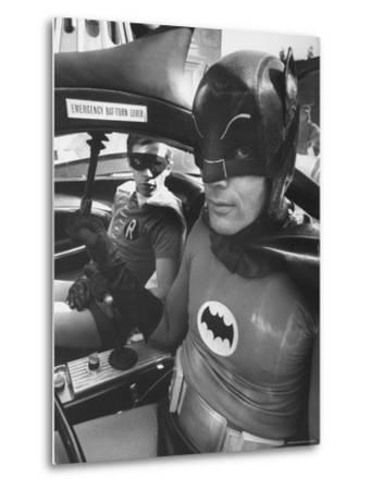 "Batman Adam West and ""Robin"" Burt Ward in Bat Mobile, on Set During Shooting of Scene-Yale Joel-Metal Print"
