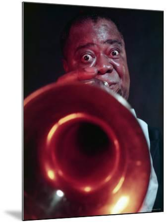 Jazz Musician Louis Armstrong Blowing on Trumpet-Eliot Elisofon-Mounted Premium Photographic Print