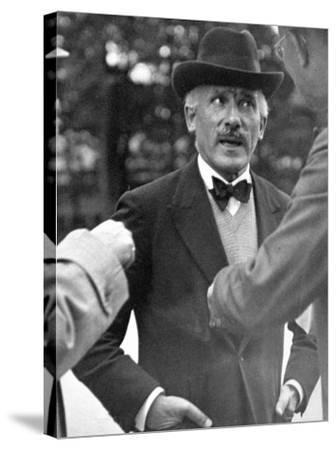 Famous Maestro Arturo Toscanini Stopping in Street and Talking to 2 Men-Alfred Eisenstaedt-Stretched Canvas Print