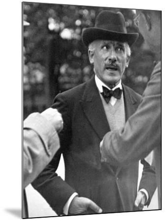 Famous Maestro Arturo Toscanini Stopping in Street and Talking to 2 Men-Alfred Eisenstaedt-Mounted Premium Photographic Print