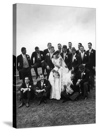 Sen. John F. Kennedy and His Bride Jacqueline Posing with 14 Ushers from Their Wedding Party-Lisa Larsen-Stretched Canvas Print