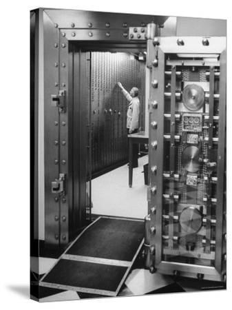 Bank Employee Selecting a Safety Deposit Box for a Customer Inside Vault Area-Bob Gomel-Stretched Canvas Print