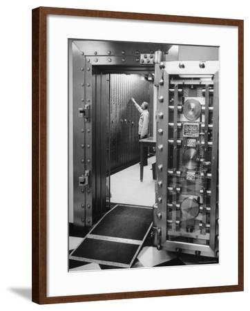 Bank Employee Selecting a Safety Deposit Box for a Customer Inside Vault Area-Bob Gomel-Framed Photographic Print