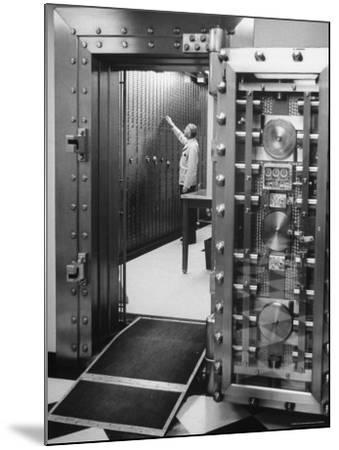 Bank Employee Selecting a Safety Deposit Box for a Customer Inside Vault Area-Bob Gomel-Mounted Photographic Print