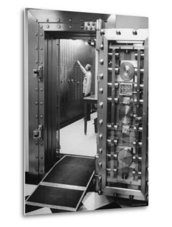 Bank Employee Selecting a Safety Deposit Box for a Customer Inside Vault Area-Bob Gomel-Metal Print
