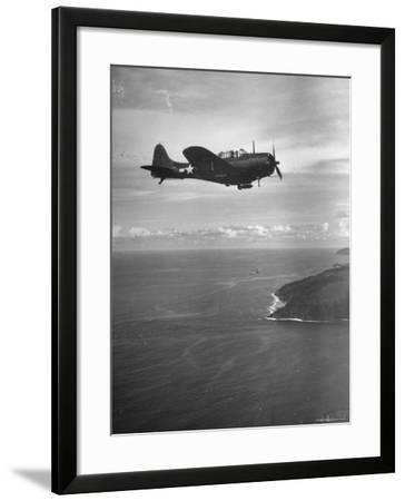 F-6 Hellcat Fighter Plane over Tanahmera Bay as Japanese Airfields at Hollandia, New Guinea-J^ R^ Eyerman-Framed Photographic Print