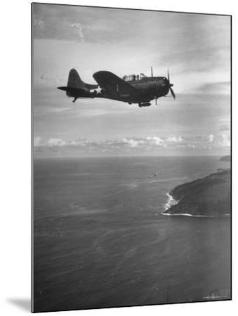 F-6 Hellcat Fighter Plane over Tanahmera Bay as Japanese Airfields at Hollandia, New Guinea-J^ R^ Eyerman-Mounted Photographic Print