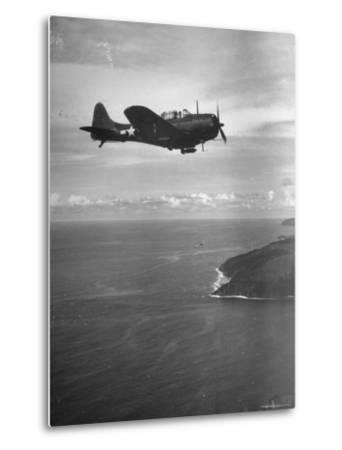F-6 Hellcat Fighter Plane over Tanahmera Bay as Japanese Airfields at Hollandia, New Guinea-J^ R^ Eyerman-Metal Print