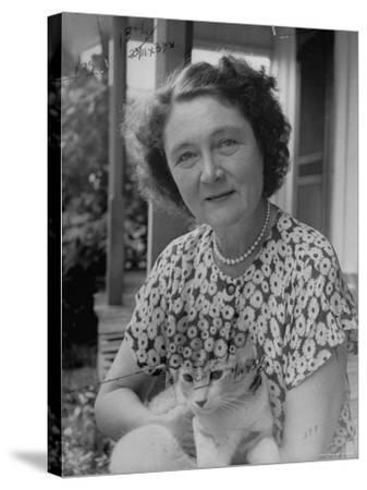 Novelist Marjorie K. Rawlings Holding Her Cat-Nina Leen-Stretched Canvas Print
