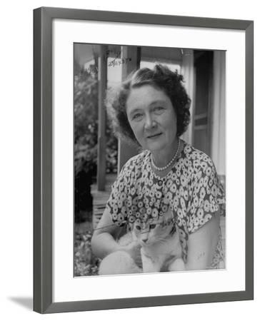 Novelist Marjorie K. Rawlings Holding Her Cat-Nina Leen-Framed Premium Photographic Print