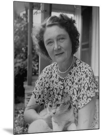 Novelist Marjorie K. Rawlings Holding Her Cat-Nina Leen-Mounted Premium Photographic Print