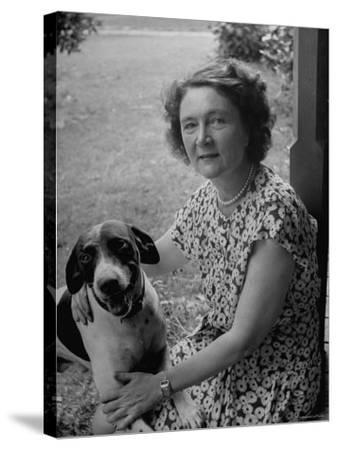 Novelist Marjorie K. Rawlings Petting Her Dog-Nina Leen-Stretched Canvas Print