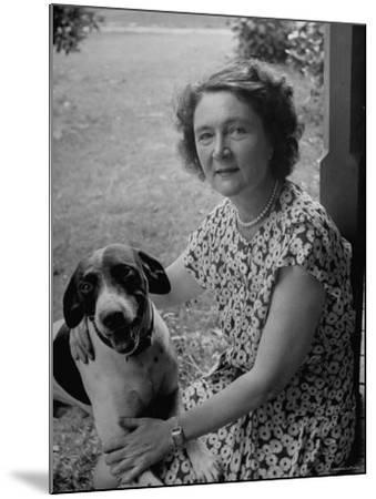 Novelist Marjorie K. Rawlings Petting Her Dog-Nina Leen-Mounted Premium Photographic Print
