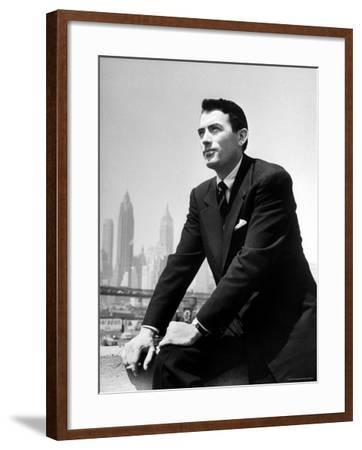 Portrait of Gregory Peck, Serious, Smoking a Cigarette-Nina Leen-Framed Premium Photographic Print