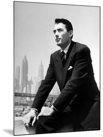 Portrait of Gregory Peck, Serious, Smoking a Cigarette-Nina Leen-Mounted Premium Photographic Print