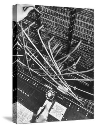 Telephone Operator's Hand Writing on Notepad in New York Telephone Co. Office-Margaret Bourke-White-Stretched Canvas Print
