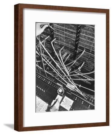 Telephone Operator's Hand Writing on Notepad in New York Telephone Co. Office-Margaret Bourke-White-Framed Photographic Print