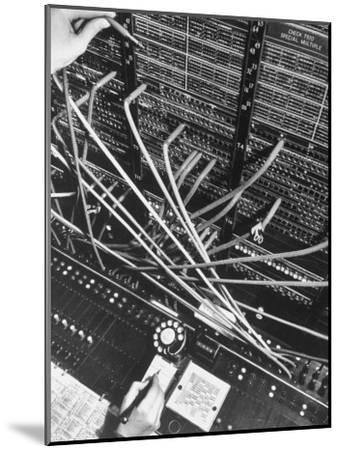 Telephone Operator's Hand Writing on Notepad in New York Telephone Co. Office-Margaret Bourke-White-Mounted Photographic Print