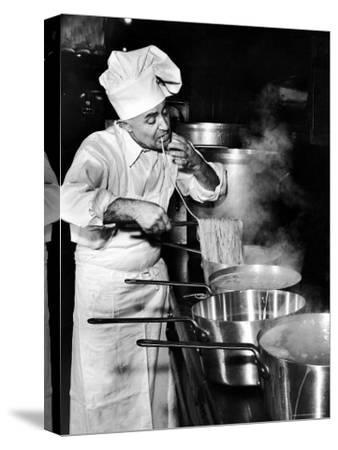 Gene Leone, Taking a Bite Test to Determine Whether the Bo Ling Spaghetti is Properly Firm-Eliot Elisofon-Stretched Canvas Print