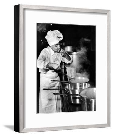 Gene Leone, Taking a Bite Test to Determine Whether the Bo Ling Spaghetti is Properly Firm-Eliot Elisofon-Framed Photographic Print
