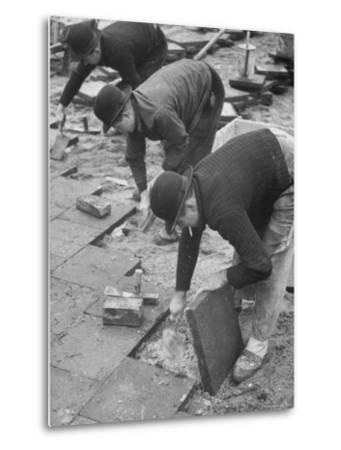Workers Paving Sidewalk in Front of Stalin Statue Are Making Highest Salaries at 24 Cents Per Hour-Ralph Crane-Metal Print