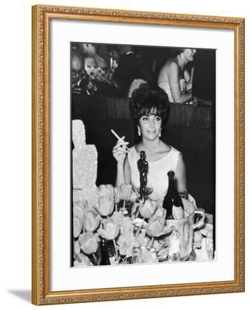 Actress Elizabeth Taylor at Hollywood Party After Winning Oscar, Which is on Table in Front of Her-Allan Grant-Framed Premium Photographic Print