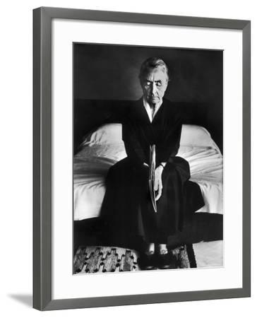 Portrait of Artist Georgia O'Keeffe Holding a Book by Leonard Baskinin Her Bedroom-John Loengard-Framed Premium Photographic Print