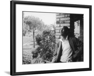 Author Ralph Ellison Against Brick Wall at American Academy on Rome Fellowship in Literature-James Whitmore-Framed Premium Photographic Print