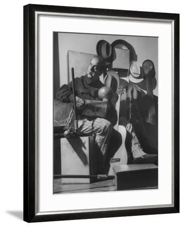 Brazilian Composer Heitor Villa Lobos Playing Native Brazilian Folk Instrument from His Collection--Framed Premium Photographic Print