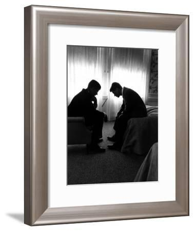 Jack Kennedy Conferring with His Brother and Campaign Organizer Bobby Kennedy in Hotel Suite-Hank Walker-Framed Photographic Print
