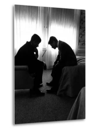 Jack Kennedy Conferring with His Brother and Campaign Organizer Bobby Kennedy in Hotel Suite-Hank Walker-Metal Print