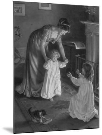 Mother with Daughters in Nightgowns, Helping Younger One Take Her First Steps--Mounted Photographic Print