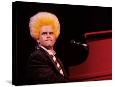 Elton John Performing, Wearing Wig--Stretched Canvas Print