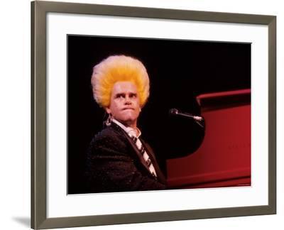 Elton John Performing, Wearing Wig--Framed Premium Photographic Print