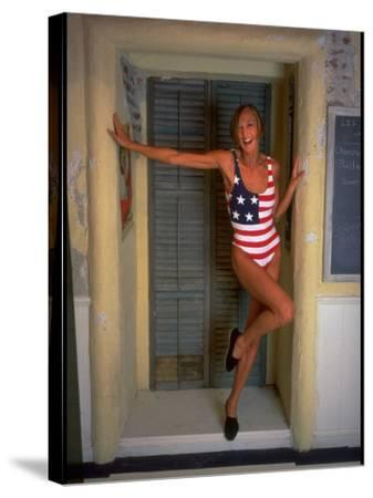 Model Standing in Doorway Modeling Ralph Lauren's Cotton and Lycra One Piece Flag Bathing Suit-Ted Thai-Stretched Canvas Print