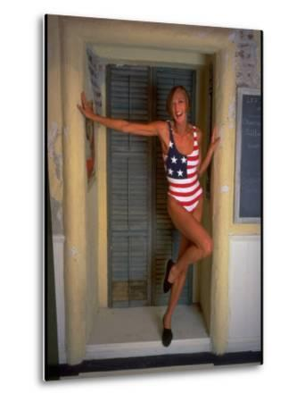 Model Standing in Doorway Modeling Ralph Lauren's Cotton and Lycra One Piece Flag Bathing Suit-Ted Thai-Metal Print