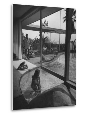 Designer Raymond Loewy Relaxing by Swimming Pool Which Runs from Outdoors Into Living Room-Peter Stackpole-Metal Print