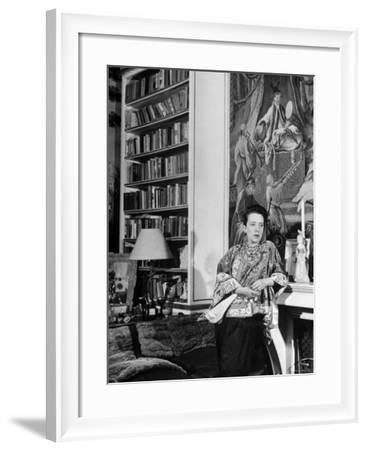 Madam Elsa Schiaparelli Enjoying Her Study Which is Filled with Treasures, Paintings, and Books-Hans Wild-Framed Premium Photographic Print