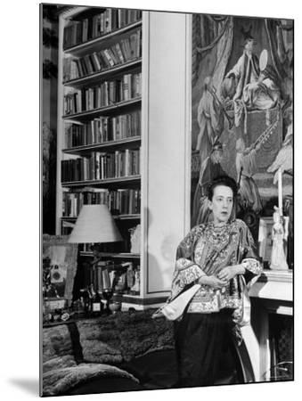 Madam Elsa Schiaparelli Enjoying Her Study Which is Filled with Treasures, Paintings, and Books-Hans Wild-Mounted Premium Photographic Print