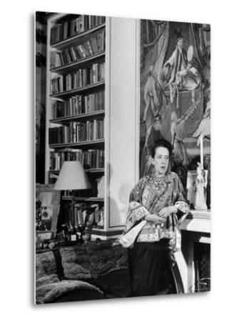 Madam Elsa Schiaparelli Enjoying Her Study Which is Filled with Treasures, Paintings, and Books-Hans Wild-Metal Print