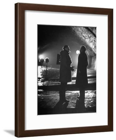 """Carol Reed Coaching Orson Welles as They Stand Against Floodlights During Filming """"The Third Man.""""-William Sumits-Framed Premium Photographic Print"""